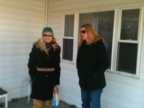 Mary and me, bringing food to the cats at the camp, Feb. 2012